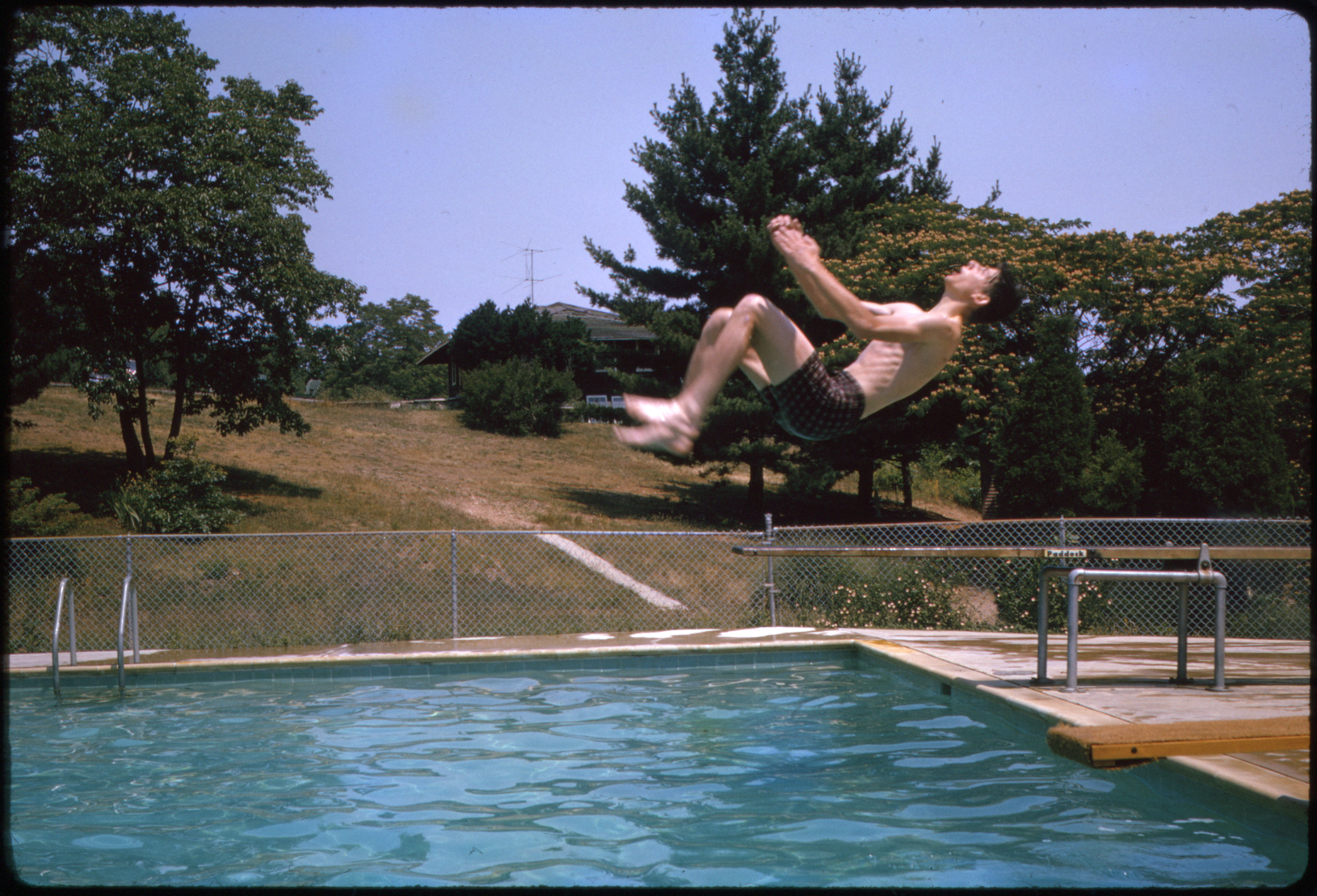 Backflip into the pool, Happy Valley Camp (Port Deposit, Md.), 1964. From Slides B141.
